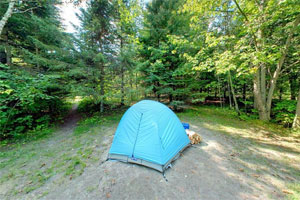 Photo of a blue tent set up at the Chase Point campsite at Scenic State Park.