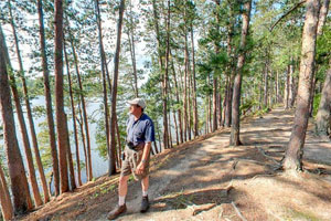 Photo of a hiker enjoying the Chase Point Trial at Scenic State Park.