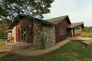 Photo of the stone and wood interpretive center building.