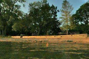 Photo of the picnic area near the swimming beach on the north shore of Lake Andrew.