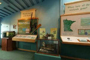 Photo of exhibits within the interpretive center with information on wetlands, geology.