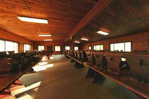 Photo of the wood-paneled mess hall at the Group Center.