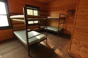Photo of the interior of the Group Center Cabin bunk beds.