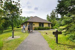 Photo of a four-season Trail Center with modern restrooms and adjacent to Pebble Beach and the main trailhead for the Gitchi-Gami State Trail.