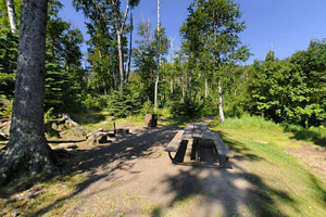 Photo of the cart-in campsite on the rocky Lake Superior shoreline.