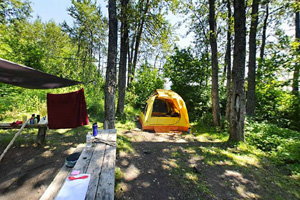 Photo of a backpack campsite on the shore of Lake Superior.