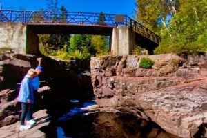 Photo of the Temperance River Lower Falls cascade under the lower bridge.