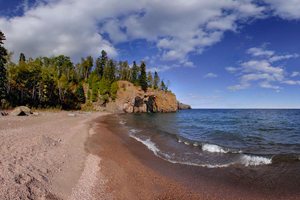 Photo of secluded Crystal Bay where you'll find Cave of the Waves, the longest sea arch on the north shore of Lake Superior.