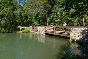 Photo of the stone and wood bridge built by the Civilian Conservation Corps, and then reconstructed in 2007.