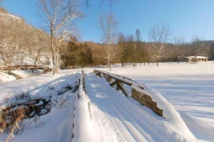 Photo of snow covering a low bridge which was constructed by the Civilian Conservation Corps.