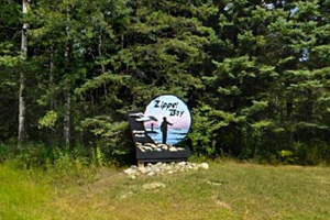 Photo of the park entrance sign that greets visitors entering Zippel Bay State Park.