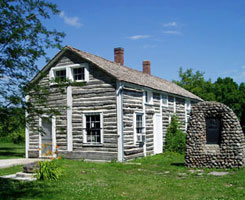 Photo of the historic cabin at the Sam Brown Memorial State Wayside.