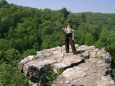 Park naturalist, Sara Grover, standing on an overlook.