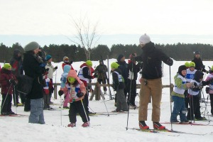 Photo of a group of young skiiers gathering for winter adventure on the park trails.