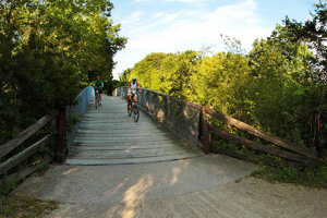 Photo of bike riders using the Orono Orchard Road bridge.