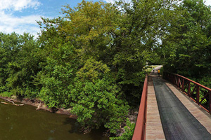 Photo of the trail bridge spanning South Fork of the Crow River.
