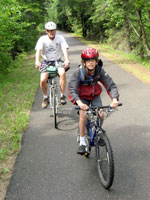 Photo of the two bicyclists riding on the paved Paul Bunyan trail.