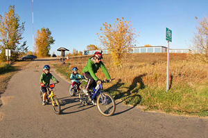 Photo of bicyclists riding on the Central Lakes State Trail near the Fergus Falls to Dalton section of the trail.