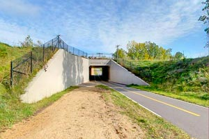 Photo of the west entrance under Count Highway 12 overpass, located in the city of Grant.