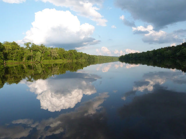 St Croix River on a calm day with reflections of water and sky. DNR Photo by Erik Wrede,