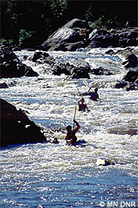 Whitewater kayakers in rapids of the St. Louis River.