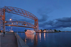 Photo of Duluth's Bayfront area, Canal Park, lift bridge reflecting the waters of Lake Superior.