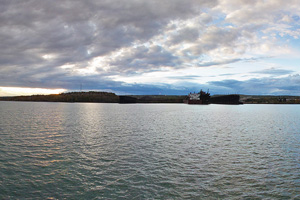 Photo of Two Harbors, with a view of working ore docks, shoreline rock-outcrops from the water.