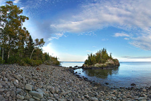 Photo of a rock cobbled beach near the public water access located at Horseshoe Bay.