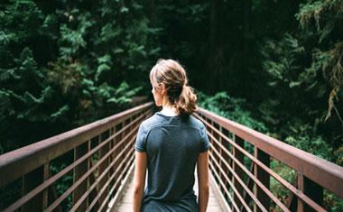 women walking over bridge