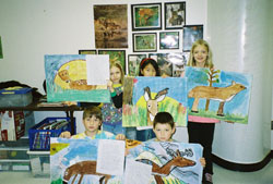 photo: group of student showing off their work