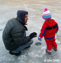 parent and toddler ice fishing