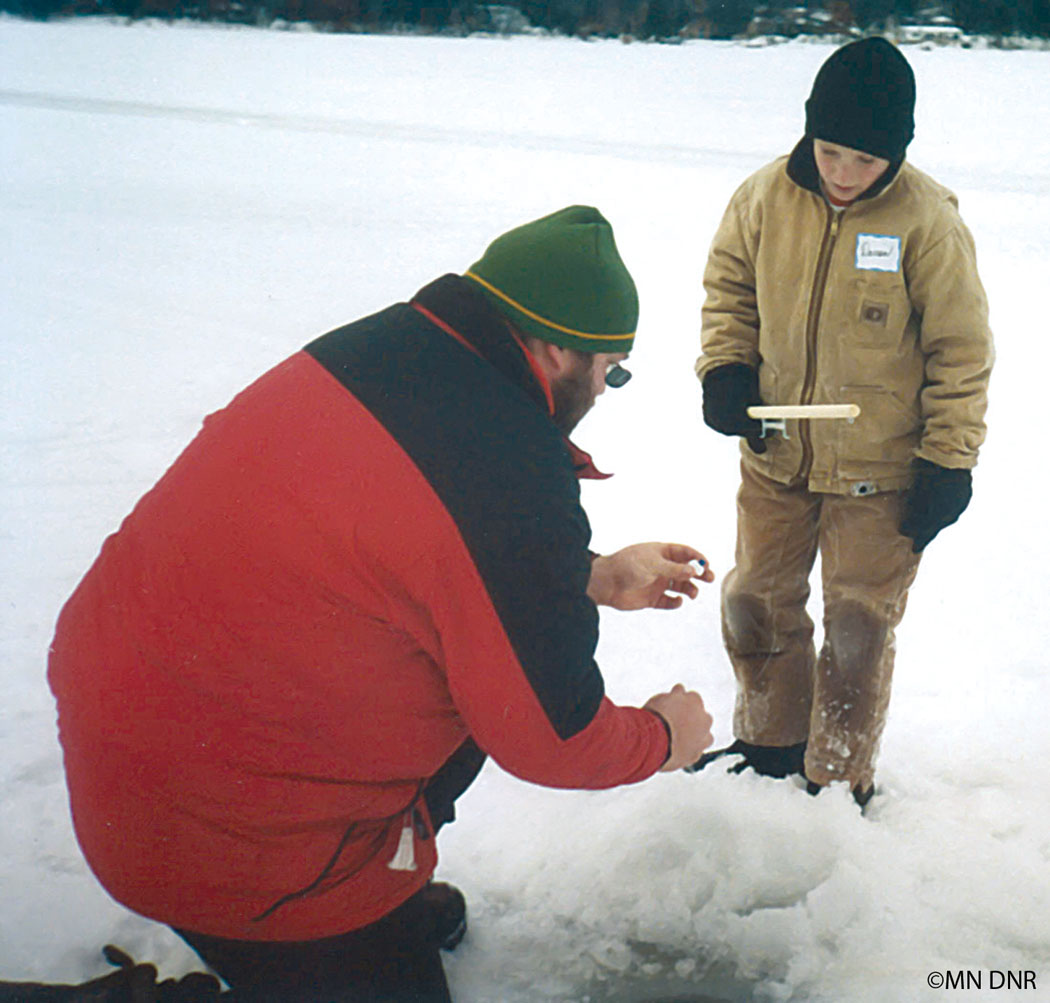 Youth learning how to ice fish