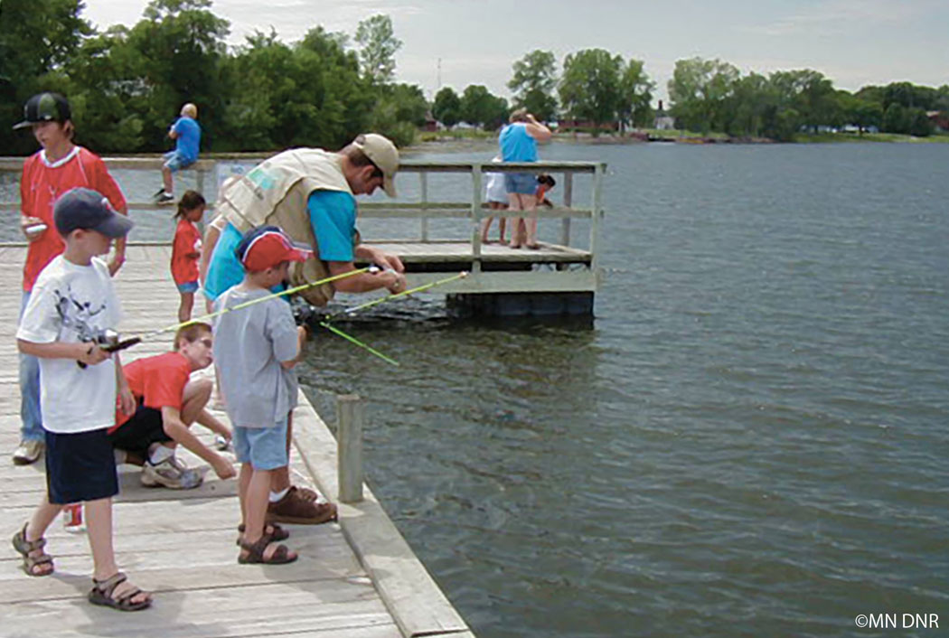 Youth fishing from a dock