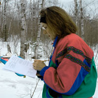 School Forest Coordinator going over check list