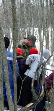 photo: students looking at example in the School Forest