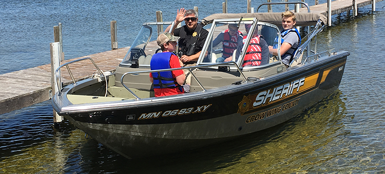 photo of child boating with officer