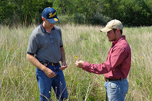 Discussing conservation practices and habitat with a private landowner.