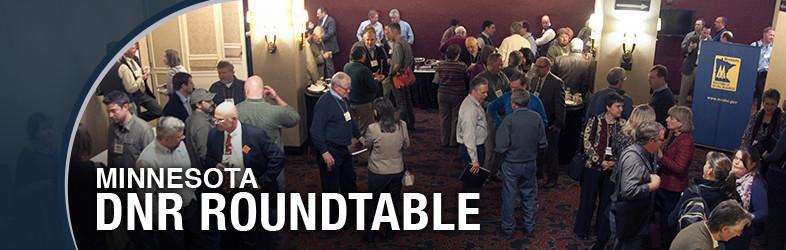 Roundtable participants gather during a break
