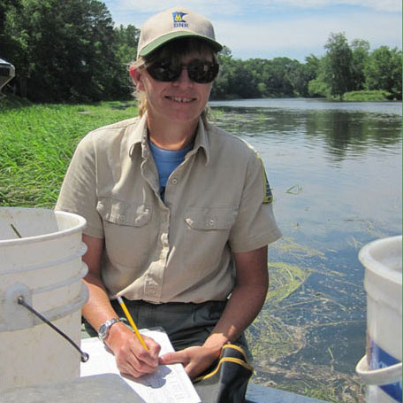A Tower area fisheries specialist records data in the field for better fish management.