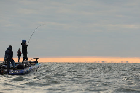 Angler fishing from a boat in the middle of Mille Lacs Lake