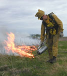 photograph lighting a controlled burn