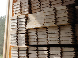 Hardwood flooring boards were dried in a solar-powered kiln.