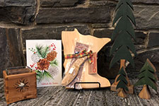 Wooden gifts of candle holder, card, cutting board and pine trees