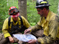 photo: Firefighters reviewing a map