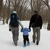 family hiking in the snow