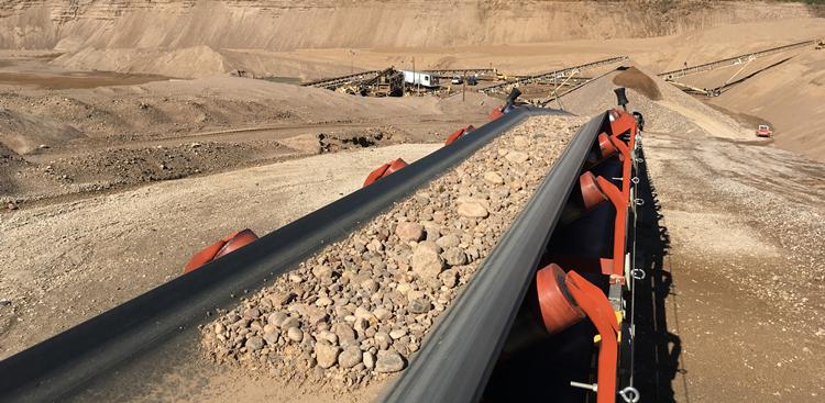 Conveyor belt transporting raw aggregate materials