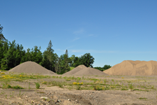 Image of gravel pit, forests, and road