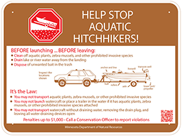 Sign 1 says Help stop aquatic hitchhikers! Before launching your boat and before leaving the water access you must clean off aquatic plants, zebra mussels, and other prohibited invasive species, drain lake or river water away from the landing, and dispose of unwanted bait in the trash. It's the law. You may not transport aquatic plants, zebra mussels, or other prohibited invasive species. You may not launch watercraft or place a trailer in the water if it has aquatic plants, zebra mussels, or other prohibited invasive species attached. You may not transport watercraft without draining water, removing the drain plug, and leaving all water-draining devices open. Penalties up to 1 thousand dollars. Call a conservation officer to report violations. Sign 2 says This is a designated infested water. Sign 3 says Protect this lake from aquatic invasive species.