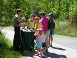 Naturalist intern talking to family group