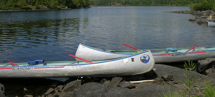 canoes near a lake